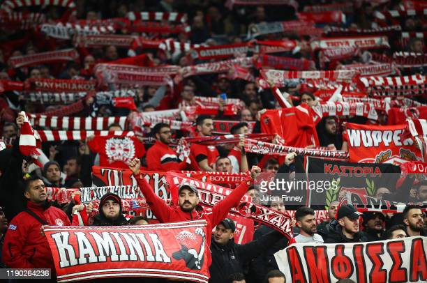 Olympiacos fans show their support during the UEFA Champions League group B match between Tottenham Hotspur and Olympiacos FC at Tottenham Hotspur...