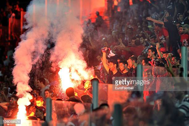 Olympiacos FC supporters celebrate a goal during the Greek Super League match between Olympiacos FC and Xanthi FC at the Karaiskakis Stadium on...