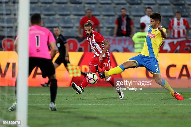 Olympiacos FC's defender from Portugal Diogo Figueiras vies with FC Arouca's defender Hugo Basto during the match between Arouca v Olympiakos match...