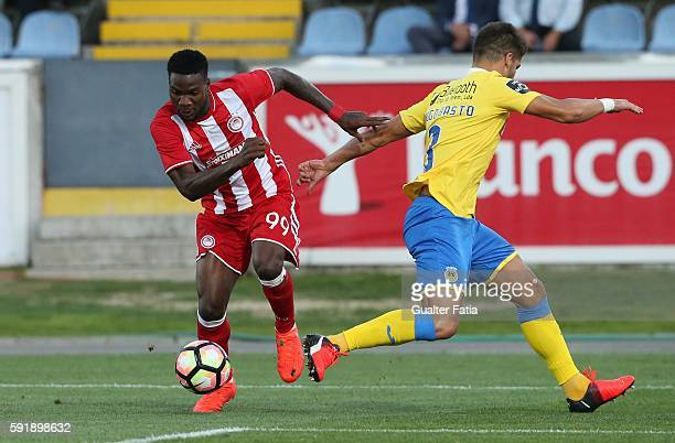 Olympiacos FC's forward from Nigeria Brown Ideye with FC Arouca's defender Hugo Basto in action during the UEFA Europa League match between FC Arouca...