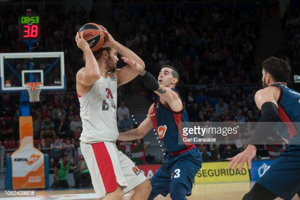 OlympiacosÕ Greek center Georgios Bogris vies with Baskonia's Italian guard Luca Vildoza during the Turkish Airlines EuroLeague match between...