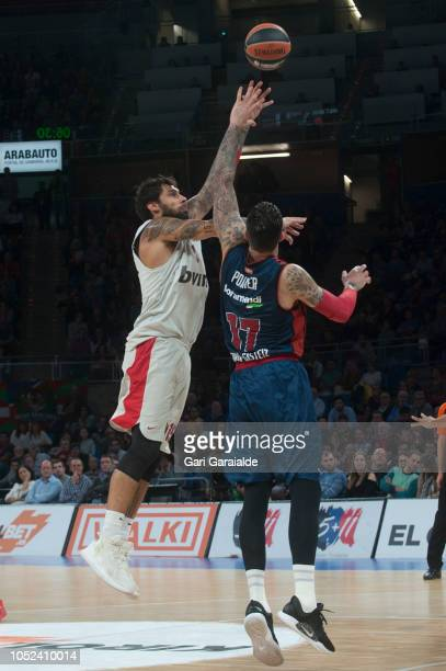 OlympiacosÕ Greek forward Georgios Printezis vies with Baskonia's French center Vincent Poirier during the Turkish Airlines EuroLeague match between...