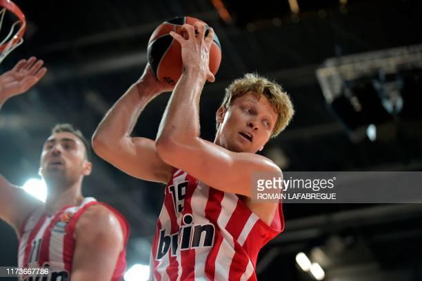 Olympiacos' Greek forward Mindaugas Kuzminskas grabs the ball during the Euroleague basketball match between LDLC ASVEL LyonVilleurbanne and...