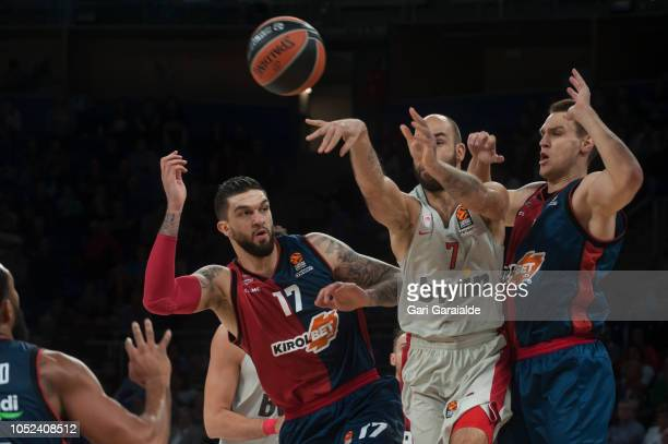 Olympiacos Greek guard Vassilis Spanoulis vies with Baskonia's French center Vincent Poirier and German Center Johannes Voigtmann during the Turkish...