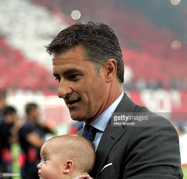 Olympiacos Head coach Michel with his new born child before the Champions League Group A soccer match between Olympiakos and Atletico Madrid at...