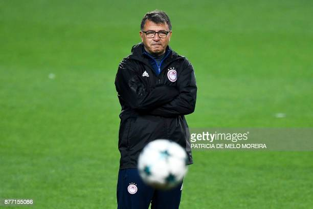 Olympiacos' head coach Takis Lemonis attends a training session at Alvalade stadium in Lisbon on November 21 2017 on the eve of the UEFA Champions...