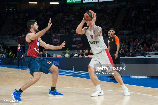 Olympiacos Latvian forward Janis Timma vies with Baskonia's Italian forward Patricio Garino during the Turkish Airlines EuroLeague match between...