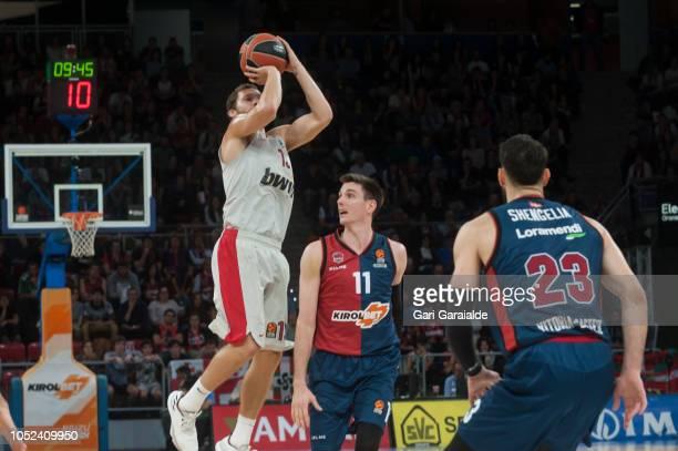 OlympiacosÕ Latvian guard Janis Strelnieks shoots the ball during the Turkish Airlines EuroLeague match between Kirolbet Baskonia Vitoria Gasteiz and...