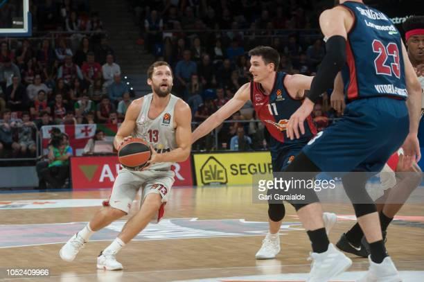 OlympiacosÕ Latvian guard Janis Strelnieks vies with Baskonia American guard Matt Janning during the Turkish Airlines EuroLeague match between...