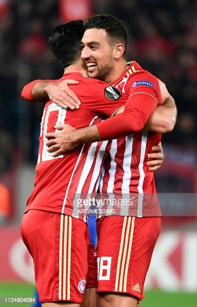 Olympiacos Mohamed Camara celebrates with a teammate after scoring during the UEFA Europa League round of 32 first leg football match between...