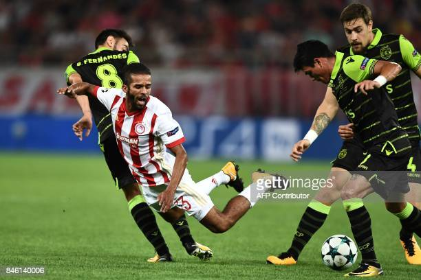 Olympiacos' Moroccan midfielder Mehdi CarcelaGonzalez and Sporting Lisbon's Argentinian defender Jonathan Silva vie for the ball during the UEFA...