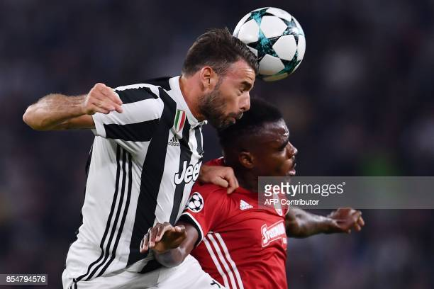 Olympiacos' Nigerian Defender Emmanuel Emenike vies with Juventus' defender from Italy Andrea Barzagli during the UEFA Champion's League Group D...