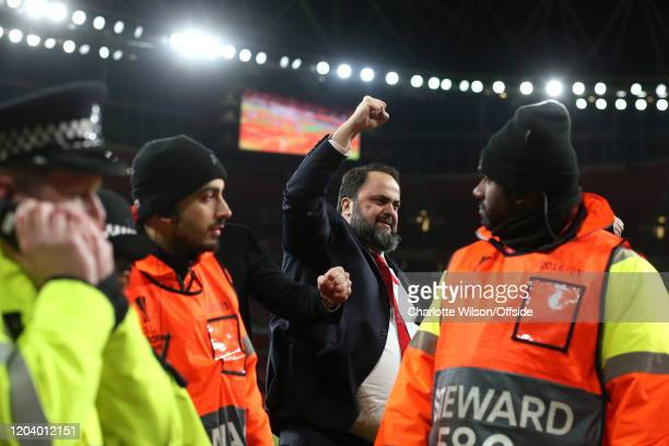 Olympiacos owner Evangelos Marinakis celebrates their victory during the UEFA Europa League round of 32 second leg match between Arsenal FC and...