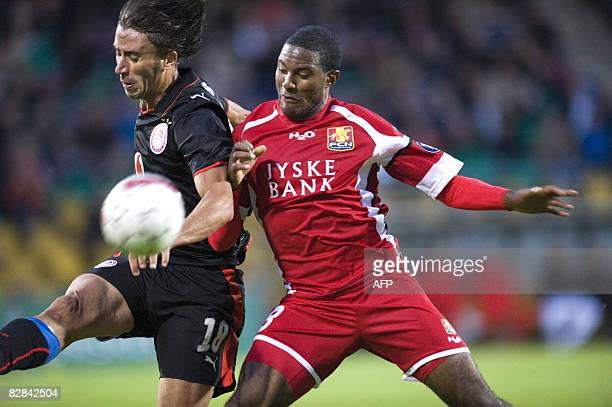 Olympiacos Paraskevas Antzas and FC Nordsjaellands Patrice Bernier fight for the ball during their UEFA Cup first round first leg football match in...