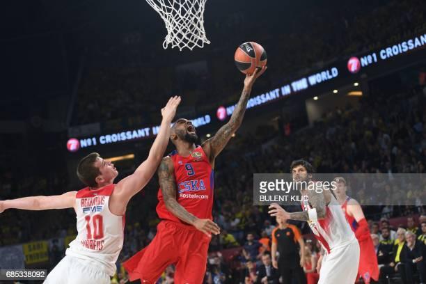 Olympiacos Piraeus Dimitrios Agravanis tries to block CSKA Moscow Aaron Jackson during the semifinal basketball match between Olympiacos Piraeus vs...