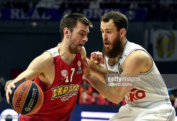 Olympiacos Piraeus' guard Vangelis Mantzaris vies with Real Madrid's guard Sergio Rodriguez during the Euroleague group basketball match Real Madrid...