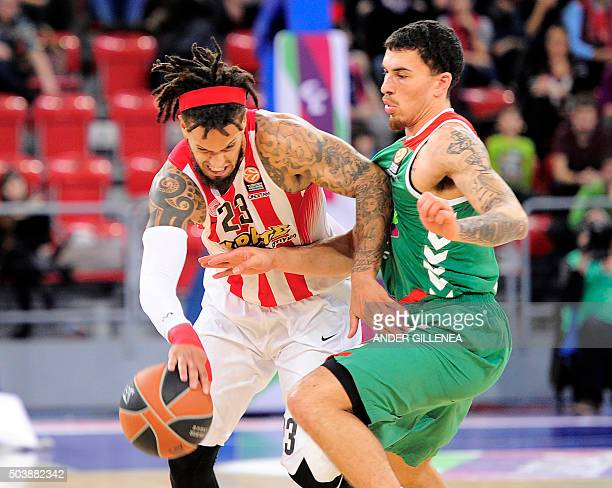 Olympiacos Piraeus' Italian guard Daniel Hackett vies with Laboral Kutxa's US guard Mike James during the Euroleague group F Top 16 round 2...