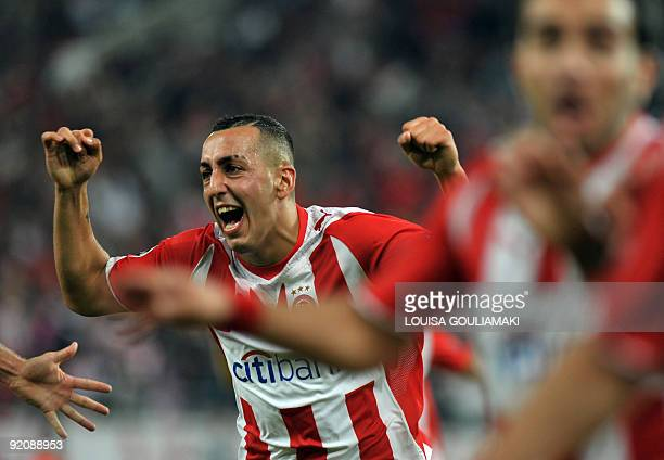 Olympiacos Piraeus Kostas Mitroglou and players celebrate their goals against Standard Liege during their UEFA Champions League match at the...
