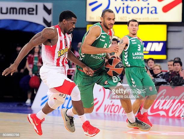 Olympiacos Piraeus' US guard Darius JohnsonOdom vies with Laboral Kutxa's Hungarian forward Adam Hanga next to Laboral Kutxa's US guard Mike James...
