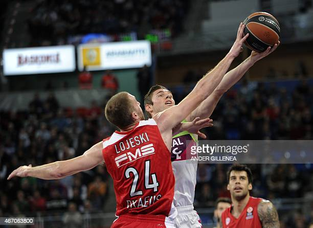 Olympiacos Piraeus' US guard Matthew Lojeski vies with Laboral Kutxa's French guard Fabien Causeur during the Euroleague group F top 16 round 11...