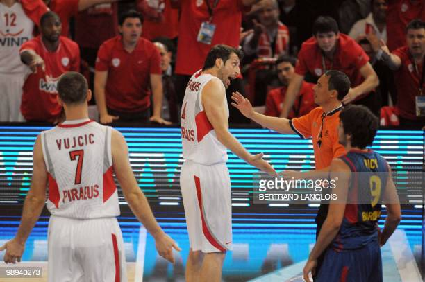 Olympiacos Piraeus's Theodoros Papaloukas speaks to a referee during the Euroleague basketball final match between Olympiacos Piraeus and Regal...