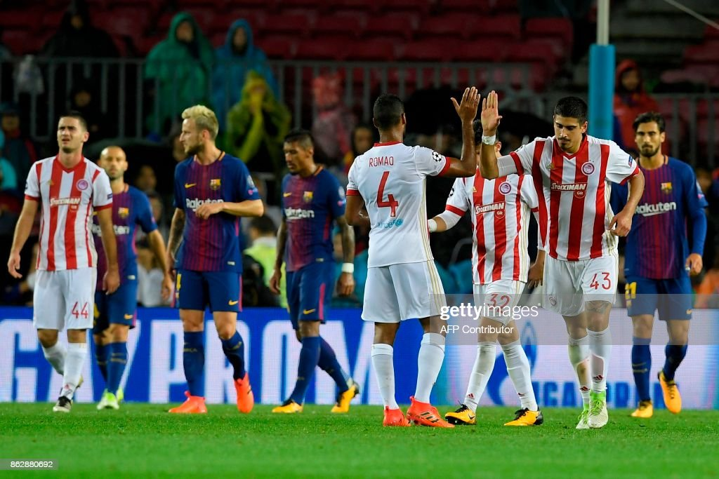 Olympiacos players celebrate a goal during the UEFA Champions League group D football match FC Barcelona vs Olympiacos FC at the Camp Nou stadium in Barcelona on Ocotber 18, 2017. /