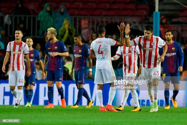 Olympiacos players celebrate a goal during the UEFA Champions League group D football match FC Barcelona vs Olympiacos FC at the Camp Nou stadium in...