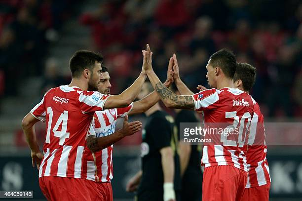 Olympiacos players celebrate during the Greek Superleague match between Olympiacos and Levadiakos at the Georgios Karaiskakis Stadium on January 18...