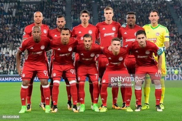 Olympiacos team players Olympiacos' Belgian midfielder Vadis Odjida Ofoe Olympiacos' FrenchTogolese midfielder Alaixys Romao Olympiacos' defender...