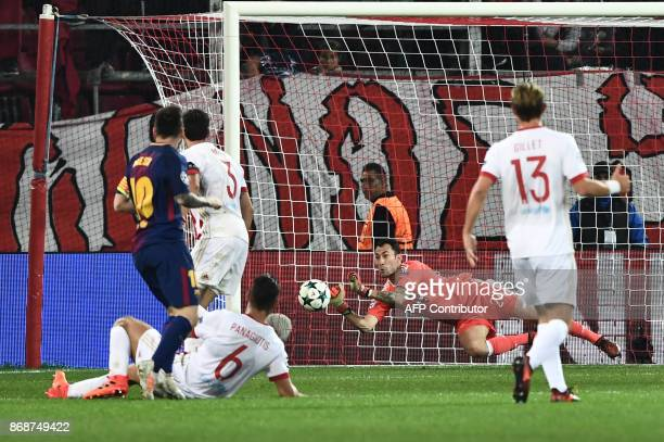 Olympiakos' Belgian goalkeeper Silvio Proto catches the ball during the UEFA Champions League group D football match between FC Barcelona and...