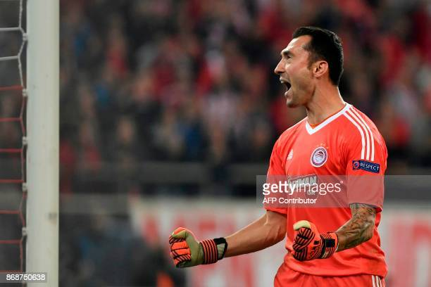 Olympiakos' Belgian goalkeeper Silvio Proto reacts at the end of the UEFA Champions League group D football match between FC Barcelona and Olympiakos...