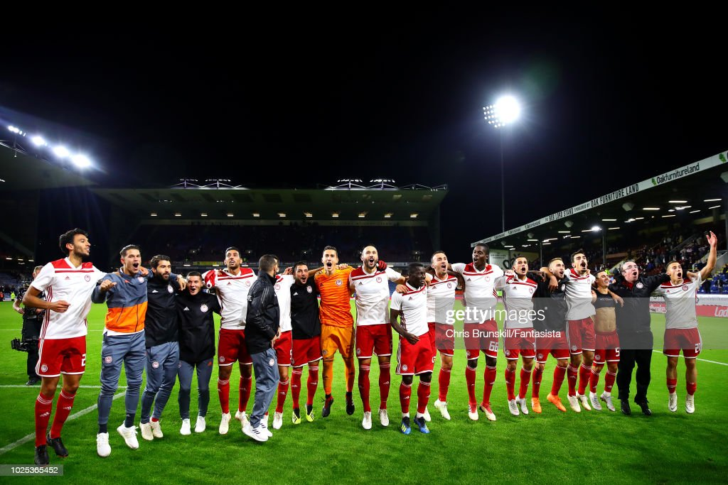 Olympiakos celebrate at full-time following the UEFA Europa League Qualifying Play-Off Second Leg match between Burnley and Olympiakos at Turf Moor on August 30, 2018 in Burnley, England.