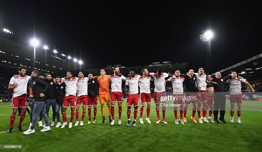 Olympiakos celebrate in front of their fans after the UEFA Europa League qualifing second leg play off match between Burnley and Olympiakos at Turf Moor on August 30, 2018 in Burnley, England.