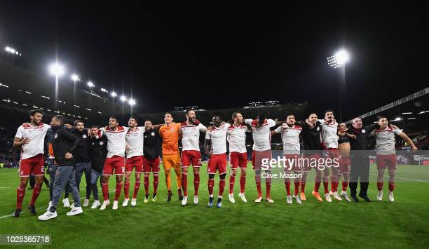 Olympiakos celebrate in front of their fans after the UEFA Europa League qualifing second leg play off match between Burnley and Olympiakos at Turf...
