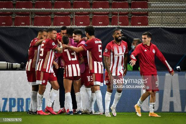 Olympiakos' Egyptian forward Ahmed Hassan celebrates with teammates after scoring a goal during the UEFA Champions League Group C first-leg football...
