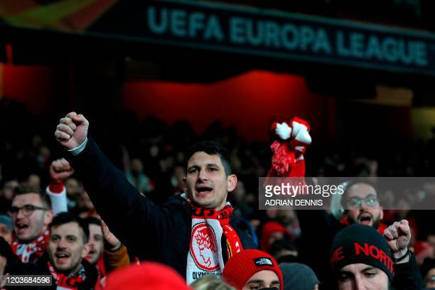Olympiakos fans await kick off in the UEFA Europa league round of 32 second leg football match between Arsenal and Olympiakos at the Emirates stadium...