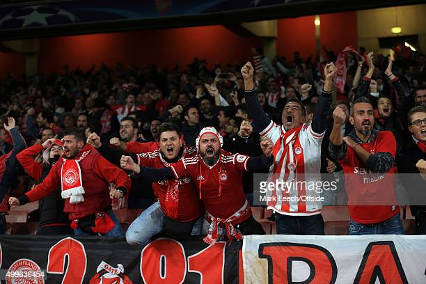 Olympiakos fans celebrate during the UEFA Champions League match between Arsenal and Olympiacos at the Emirates Stadium on September 29 2015 in...