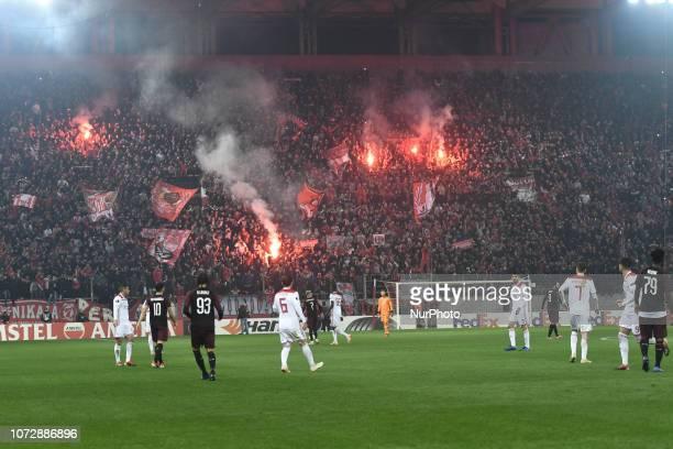 Olympiakos' fans celebrates during their UEFA league match Olympiacos FC and AC Milan at the Karaiskaki stadium in Piraeus on December 13 2018