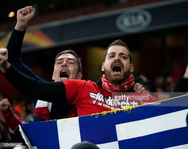 Olympiakos fans enjoy the prematch atmosphere during the UEFA Europa League round of 32 second leg match between Arsenal FC and Olympiacos FC at...