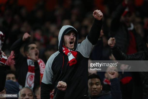 Olympiakos fans sings during the 2019/20 UEFA Europa League 1/32 playoff finale game between Arsenal FC and Olympiakos FC at Emirates Stadium, in...