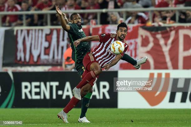 Olympiakos' forward Ahmed Hassan fights for the ball with Real Betis' Defender Sidnei Andres Guardado during the UEFA Europa League Group F football...