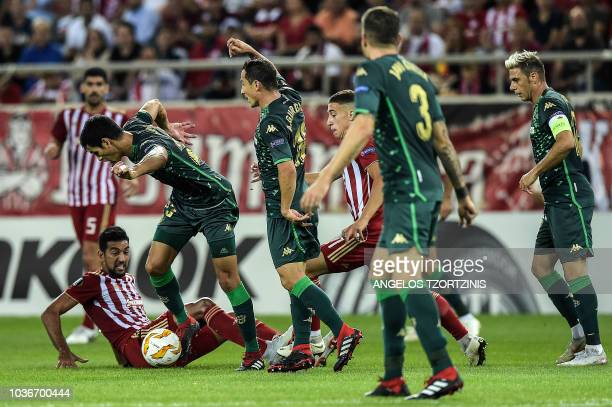 Olympiakos' forward Ahmed Hassan fights for the ball with Real Betis' defender Aissa Mandi during the UEFA Europa League Group F football match...
