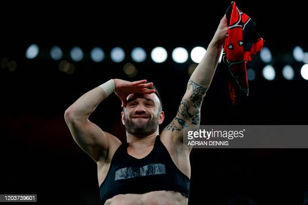 Olympiakos' French midfielder Mathieu Valbuena celebrates on the pitch after the UEFA Europa league round of 32 second leg football match between...