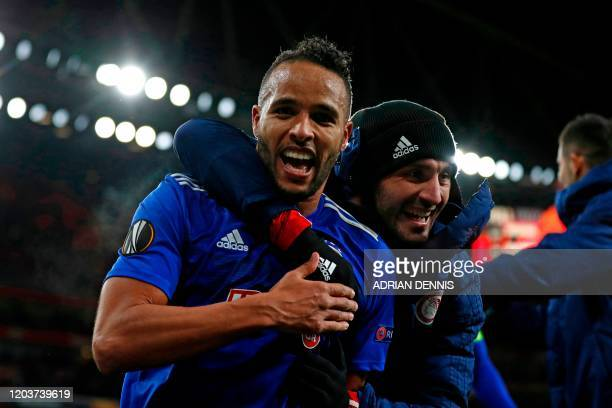 Olympiakos' Frenchborn Moroccan striker Youssef ElArabi celebrates on the pitch after the UEFA Europa league round of 32 second leg football match...