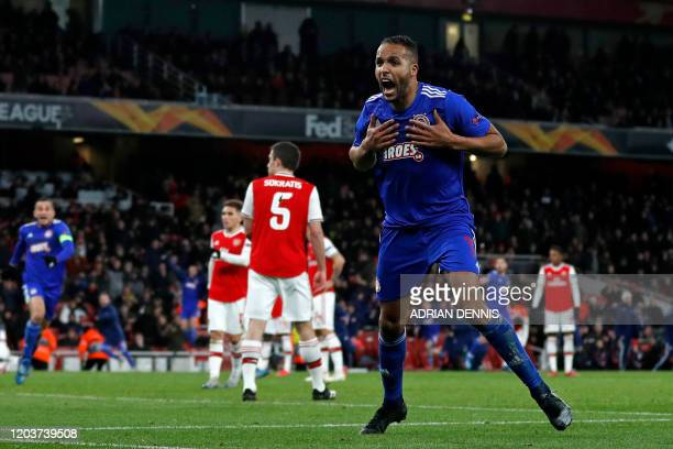 Olympiakos' Frenchborn Moroccan striker Youssef ElArabi celebrates after scoring their late goal in extra time during the UEFA Europa league round of...