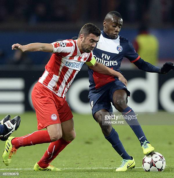 Olympiakos' Greek defender Giannis Maniatis vies with Paris SaintGermain's French midfielder Blaise Matuidi during an UEFA Chanpions League group C...