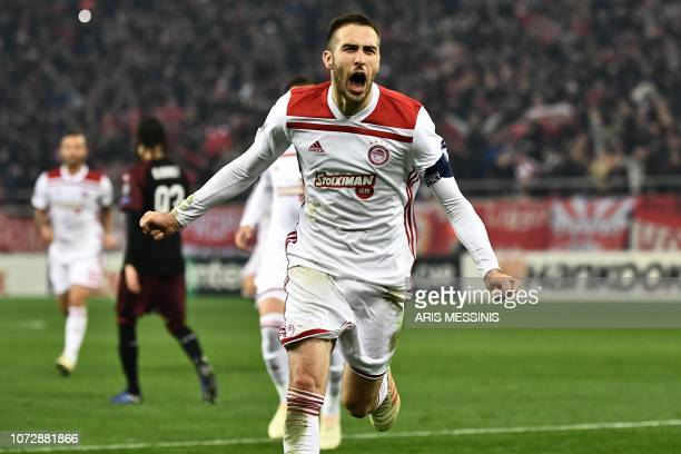 Olympiakos' Greek midfielder Kostas Fortounis celebrates after scoring during their UEFA Europa league match Olympiacos FC and AC Milan at the...