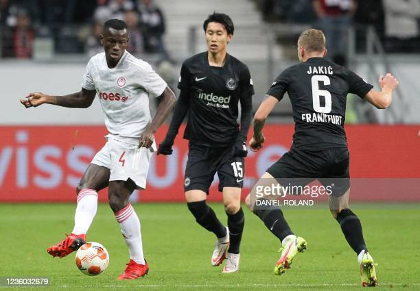 Olympiakos' Guinean midfielder Mohamed Mady Camara and Frankfurt's Japanese midfielder Daichi Kamada vie for the ball during the UEFA Europa League...