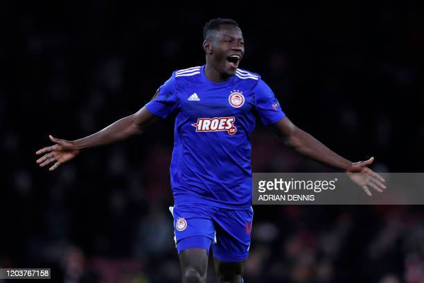 Olympiakos' Guinean midfielder Mohamed Mady Camara celebrates on the pitch after the UEFA Europa league round of 32 second leg football match between...