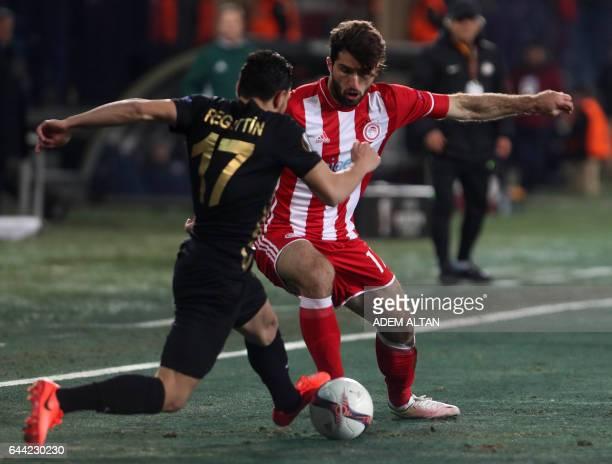 Olympiakos' Iranian forward Karim Ansarifard tackles Osmanlispor's MorrocanFrench midfielder Adrien Regattin during the UEFA Europa League round of...
